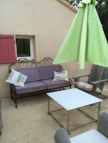 One of the outdoor seating areas overlooking the pool at the holiday home
