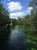 The River here is incredibly clear with vibrant green weeds under the surface