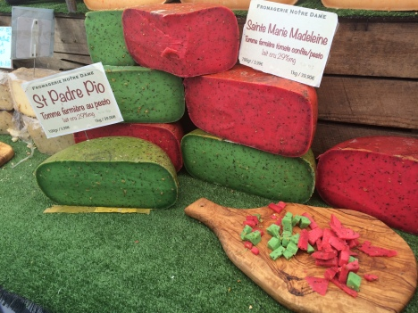 Bright clolours of tomato & pesto cheese on a stall at L'Isle Sur La Sorgue market