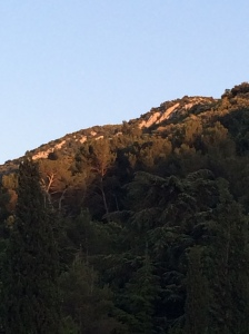 Final rays of sun catching the top of the Luberon behind the house