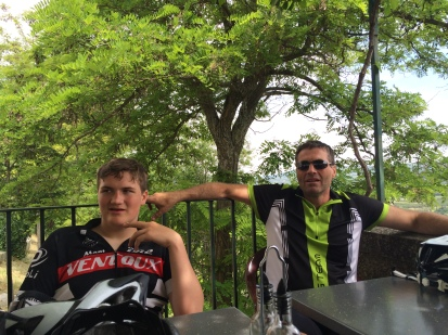 Hubby & youngets relaxing on the terrace of the Cafe De France after cycling up